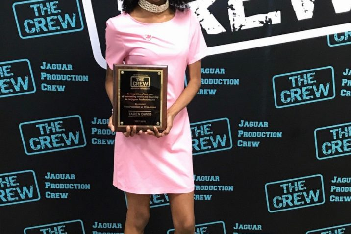 student holding an award