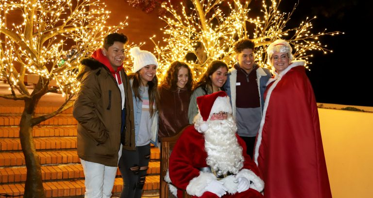people standing for a photo with Santa