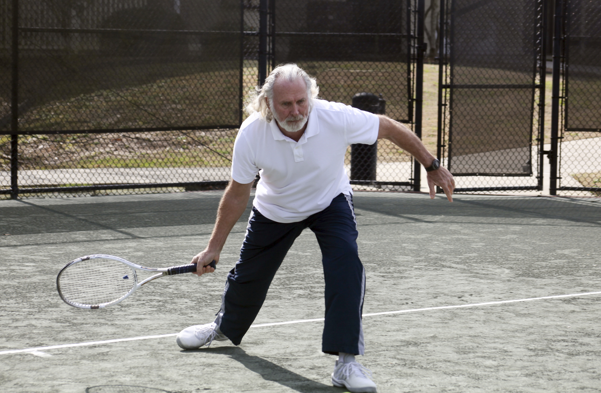Man hitting a tennis ball.