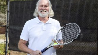 A man holding a tennis racket