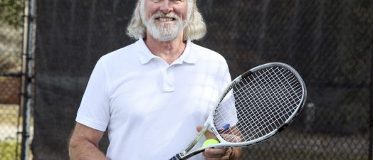 A man holding a tennis racket