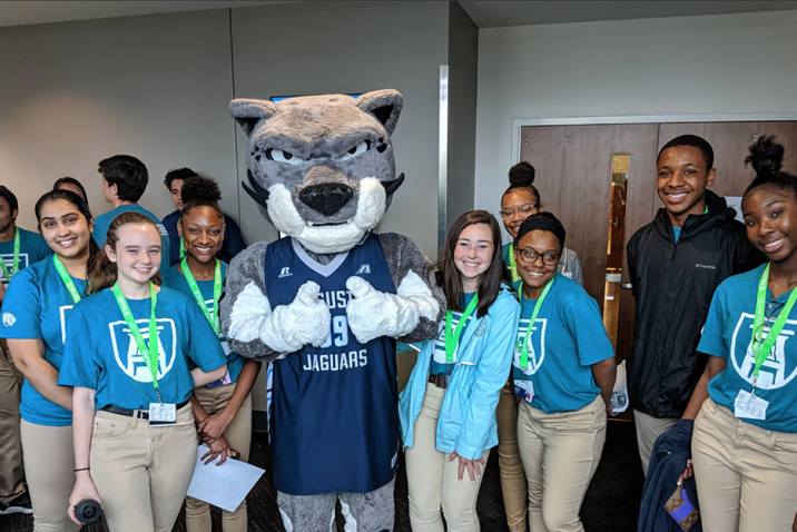 Students smiling with the university mascot