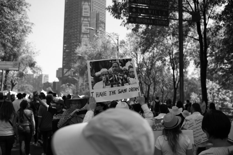 Man holding sign in crowd