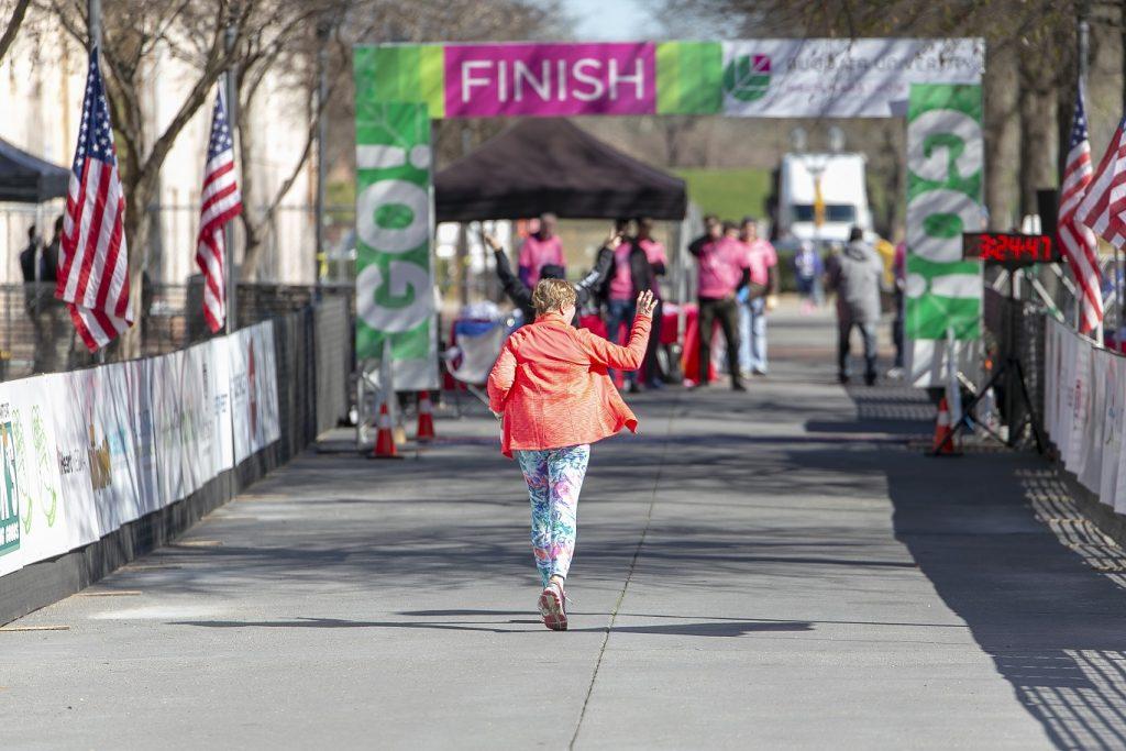 marathon runner back toward finish line
