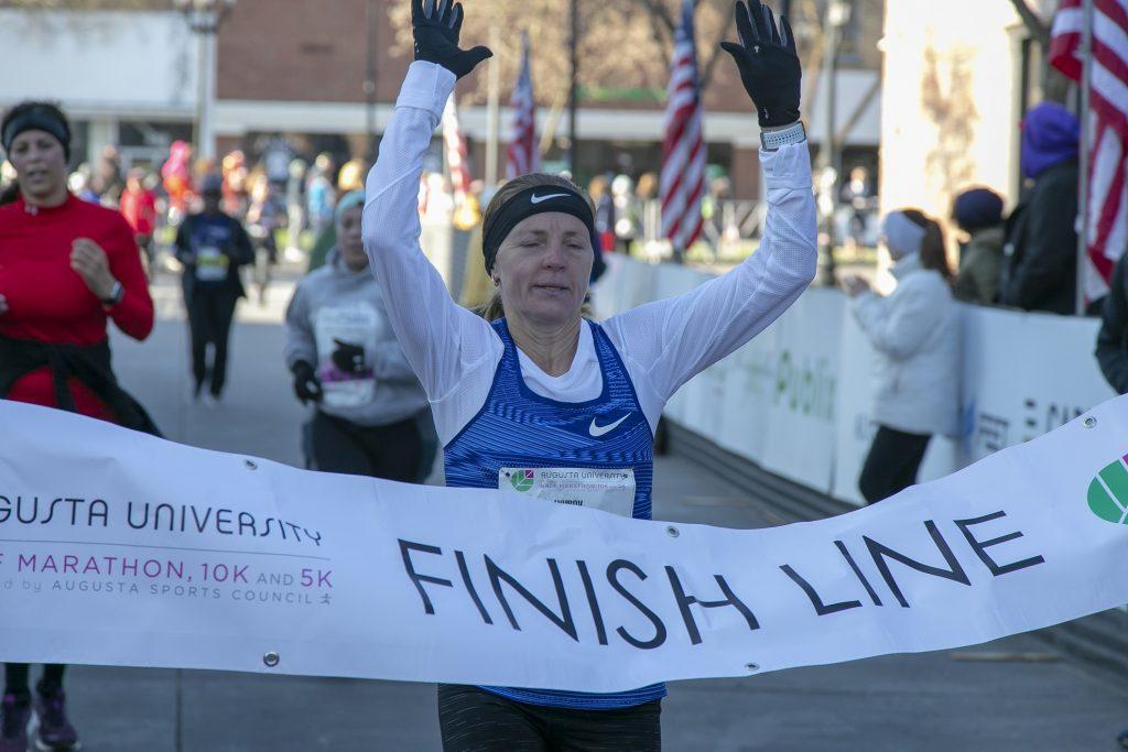 marathon runner breaks finish line