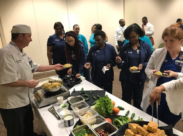 Chef serves people in serving line