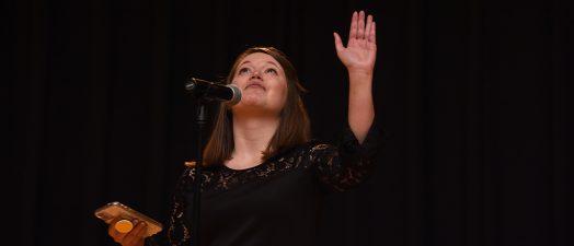 Woman reaching up