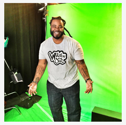 image of man in a grey Wild 'N Out T-shirt