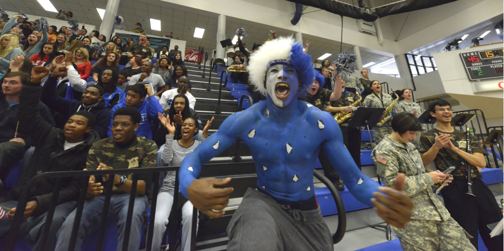 man screaming with school spirit