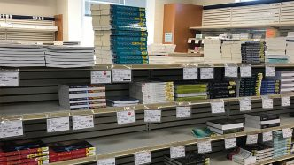 shelves lined with college textbooks