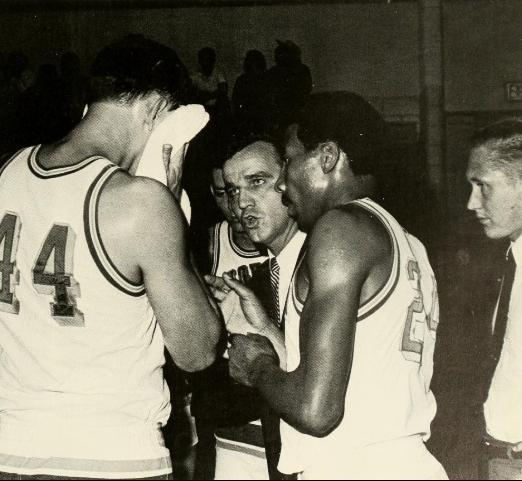 Man coaching players