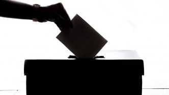 A person casting their vote.