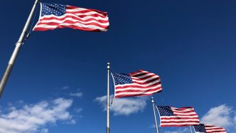 American flags waving in the sky.
