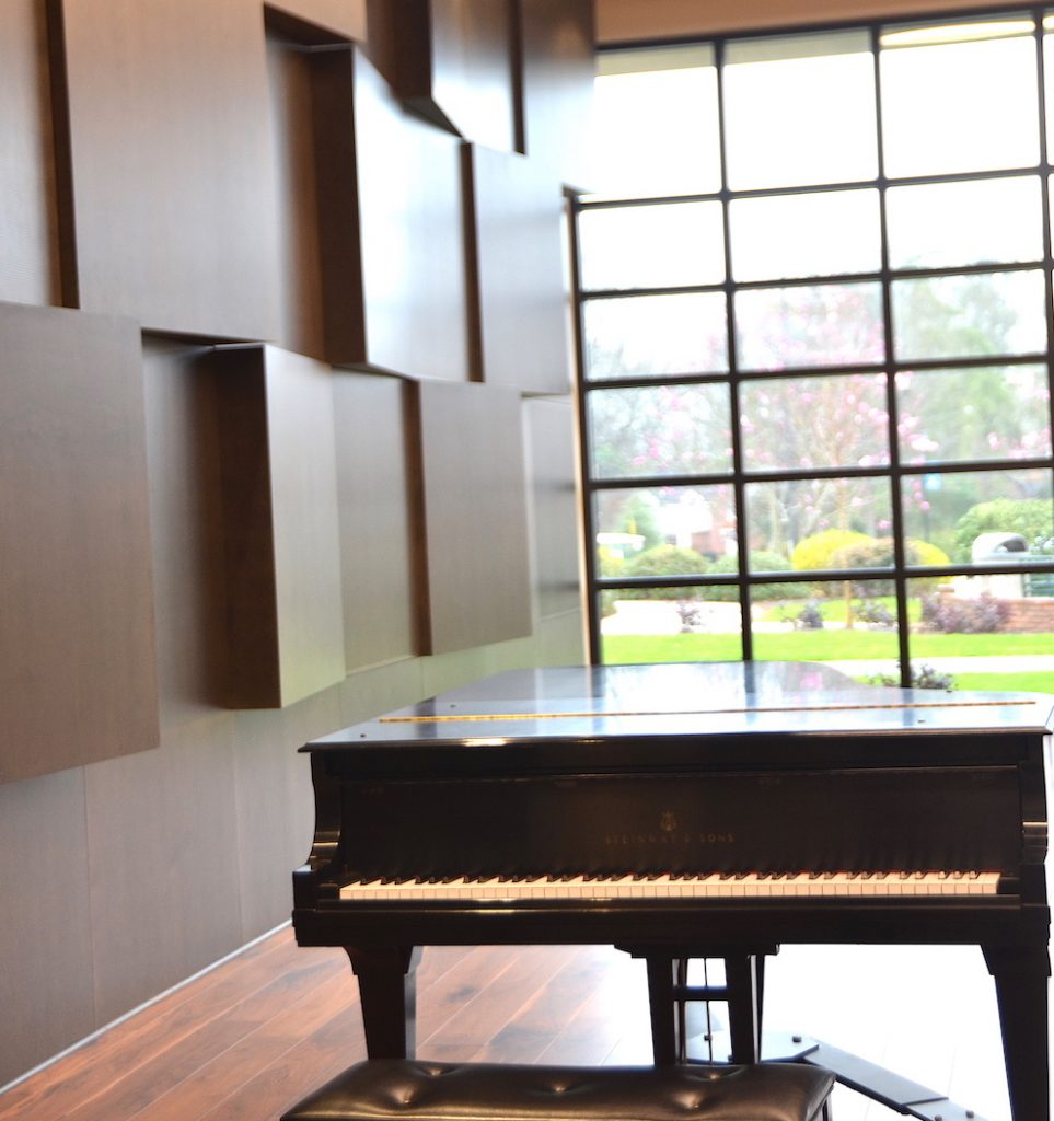 piano in a recital hall.