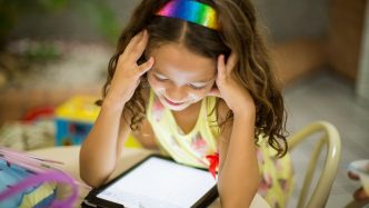 A child reads on a digital tablet.