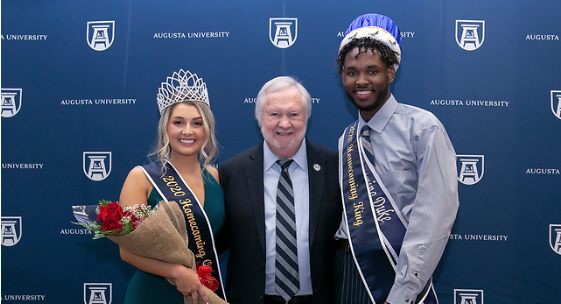 Homecoming king and queen with college president
