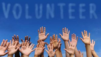 Volunteers raising hands