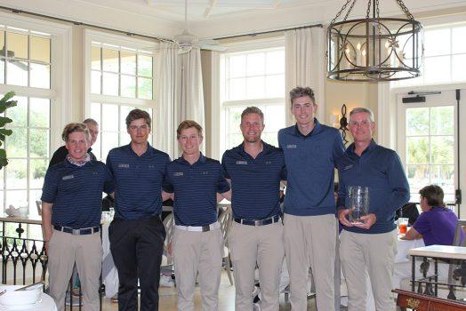 Men posing with trophy