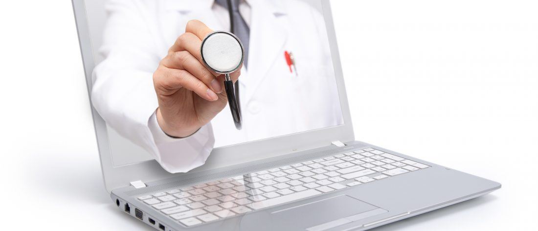 Telemedicine concept. Doctor with a stethoscope on the computer laptop screen.