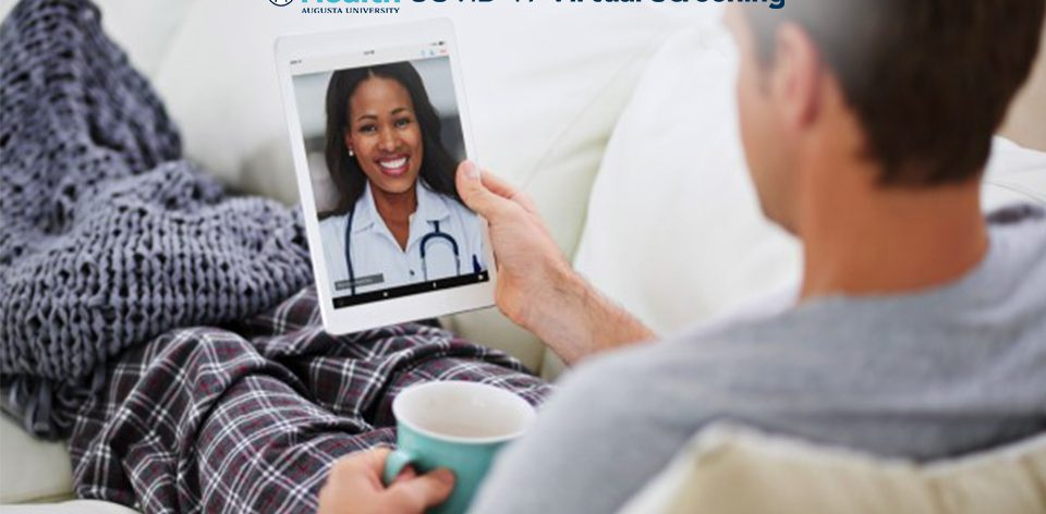 Man holding tablet talking to doctor