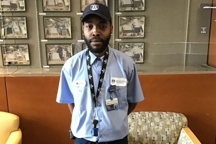 Man in uniform wearing Augusta University ball cap