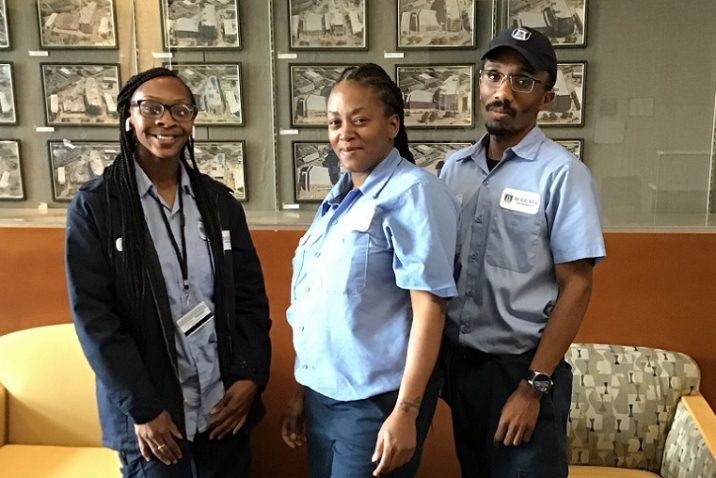 Three EVS workers at Augusta University in uniform.