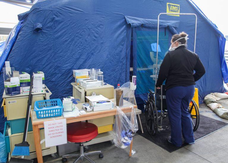 nurse near tent