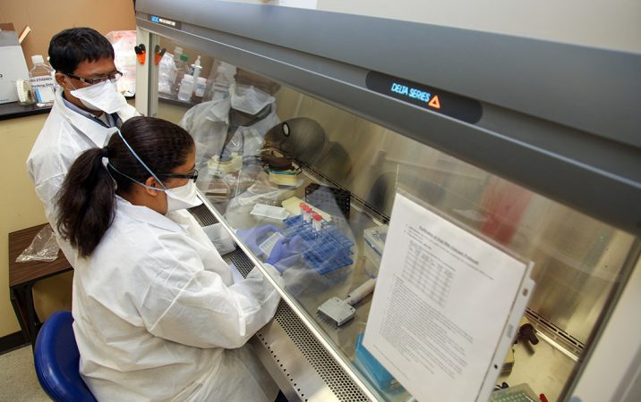 Two people working in lab