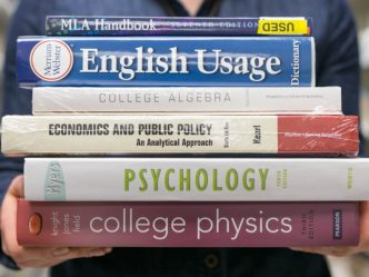 stack of 6 college textbooks, including psychology, physics and algebra