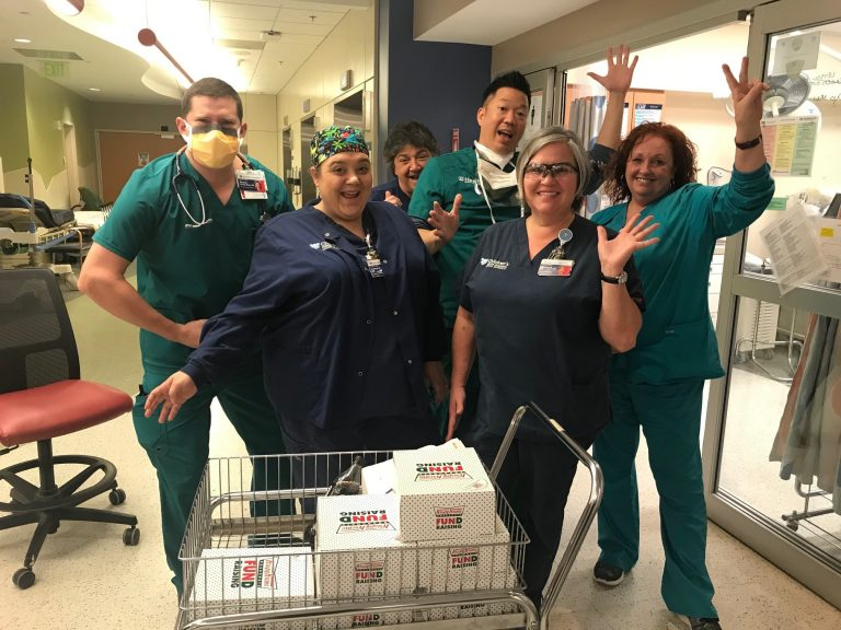 nurses with donuts