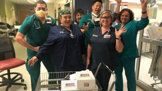 Health care workers with doughnuts