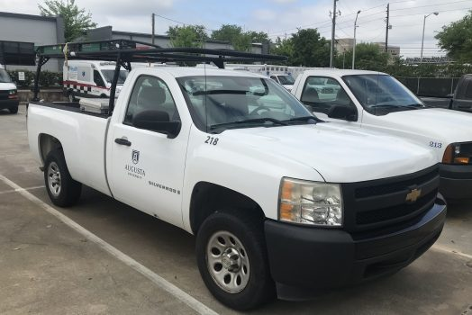 White work truck with Augusta University logo on passenger door