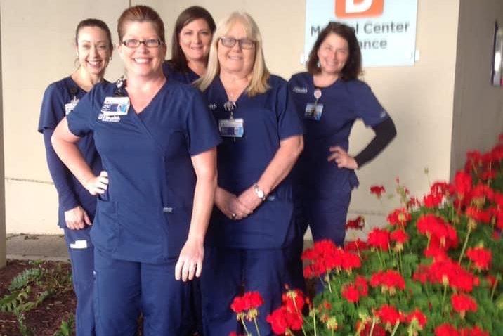 five nurses with flowers