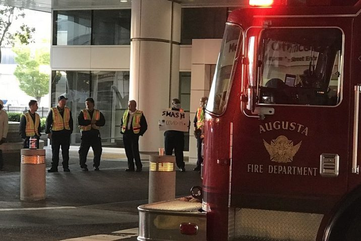 firefighters standing outside