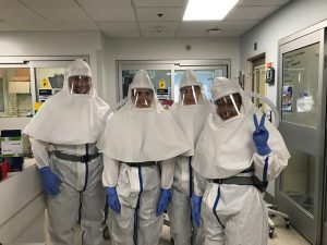 Nurses in protective suits