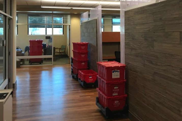 Red Moving Bins in office