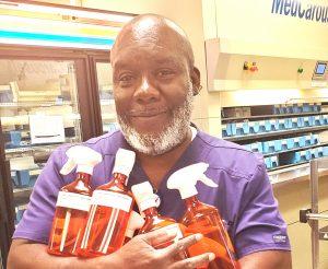 man holding sanitizer