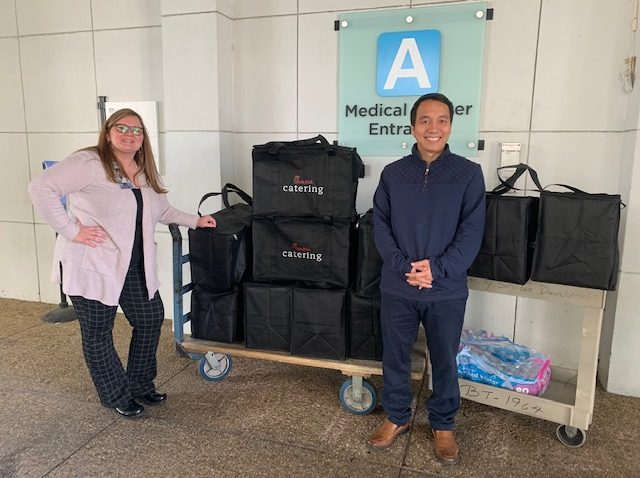 man and woman with catering bags