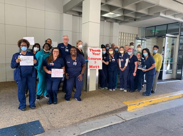 nurses holding signs