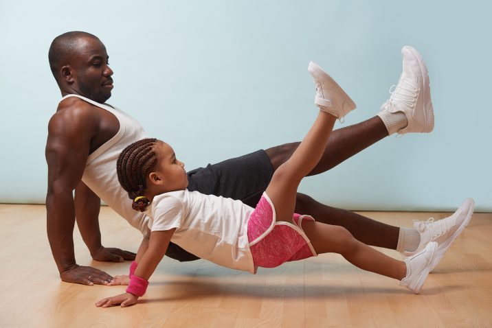 Father and child exercising