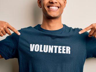 Man in volunteer shirt