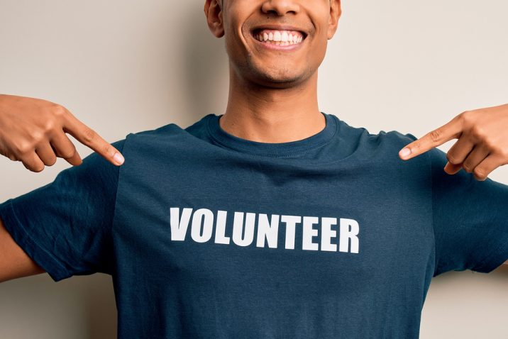 Man in volunteer shirt