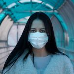 Woman with a surgical mask on her face.