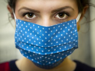 Woman with a blue face mask.