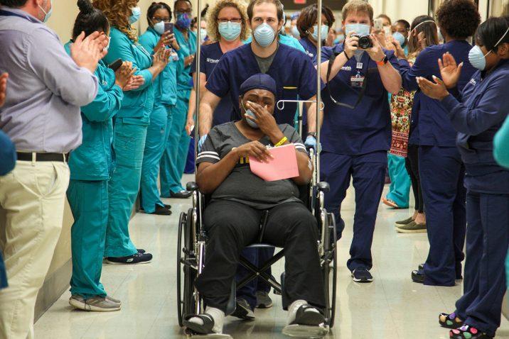 Woman in wheelchair in hallway