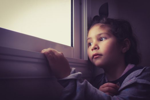 Girl looking out of the window