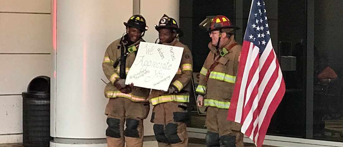 Firefighters with flag