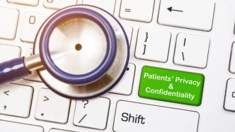 stethescope on keyboard with patient privacy button