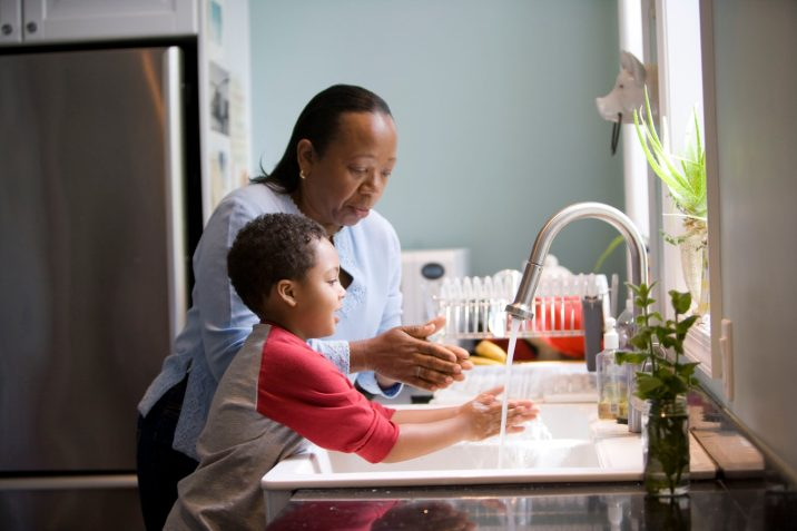 Mother and son washing their hands