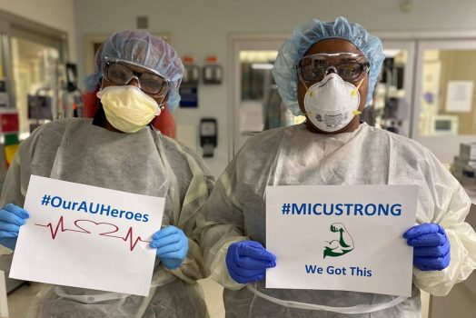 nurses holding signs